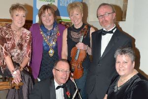 Archy McNeill (right) at St. Cedma's Church before a concert in aid of Larne Foodbank in 2013. INLT 46-331-PR