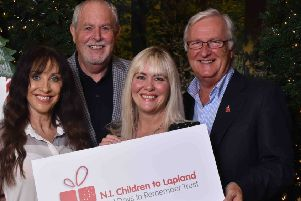 Gerry Kelly,  incoming president of The Northern Ireland Children to Lapland and Days to Remember Trust; Colin Barkley, the charity's new chair; Fiona Williamson, charity co-ordinator;and Lynne Rodgers, wife of the charity's late founder, Jack Rodgers MBE, and charity trustee.