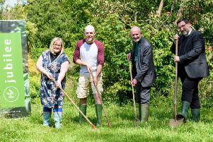 Rev. Ruth Turner of Millbrook Church of the Nazarene, Dr. Jonny Hanson of Jubilee Farm, Rev. Colin McClure of First Larne Presbyterian, Rev. Chris Skillin of Larne Methodist Church get to work.