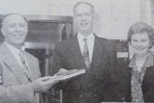Manager of Carrick Adult Centre Bill McCormick receives equipment from Trevor Monteith, chair of the Parents' Association. Included is John McQuarry and Maureen Anderson. 1991