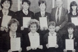 Duke of Edinburgh Bronze Award winners from Larne High School pictured with headmaster James Parker and Margaret Lindsay, teacher in charge of the group. 1989