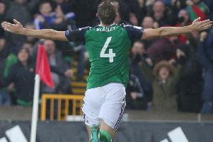 Gareth McAuley celebrates scoring against Azerbaijan
