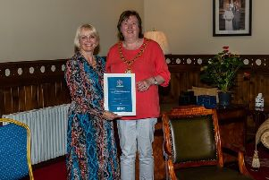 Mayor Maureen Morrow presents a certificate to Larne Drama Circle Vice-Chairman Lorna Ringland in recognition of 70 years of the Circle.'(PICTURES KINDLY SUBMITTED)