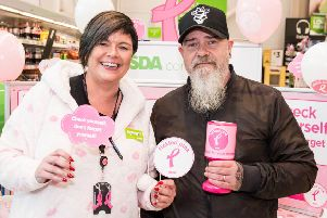 Customer Paul Whiteside joins Catherine McCallion, Asda Larne Community Champion, for Tickled Pink activity in aid of charity.