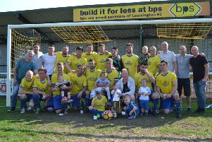 Westlea Wanderers celebrate their Cancer Cup final success.
