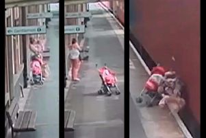 VIDEO: Chilling footage shows moment child's buggy rolls into the path of freight train in Warwickshire