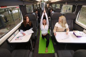 Yoga instructor Ellie Di Martino and Chiltern Railways passengers in the 'mindfulness zone'. Photo: Chiltern Railways NNL-180504-154437001