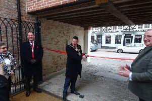 Warwick mayor Richard Eddy cutting the ribbon at Jury Place. Photo submitted.
