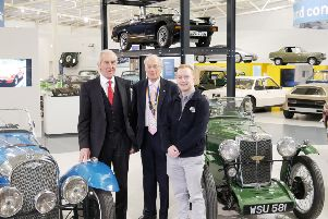 Leamington Rotary Club president David Leigh-Hunt (centre) with David Derbyshire from Kia Warwick (left) and Mark Treadwell from the marketing department of the British Motor Museum at Gaydon.