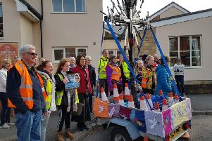 The cross of knives at Kenilworth Methodist Church and of the crowd who assembled to see the walkers depart. Photo submitted.