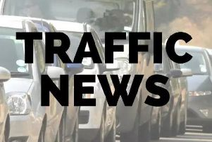 There are long tailbacks and delays in the area.