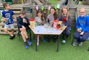 Pupils from year 5 who helped to set up and man the stall entitled: 'Guess how much popcorn is in the jar.'