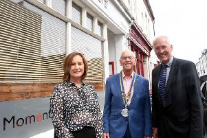 Leamington Rotary Club president Colin Robertson with Alaistair Clark, Managing Director AC Lloyd and Judy Timson, clinical advisor care & community team, Moore & Tibbits solicitors.