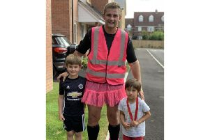 Kineton Primary School teacher Dean Sanderson and his sons, Leo and Joel.