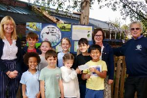 Lion Club Treasurer Neil Chisholm with Head Teacher Julie Miles, teaching assistant Helen Goddard and pupils from Clapham Terrace Primary School. Photo submitted.