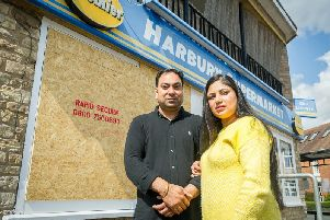 Bob Dhillon & Gurpreet Kaur outside the store after the burglary in August.