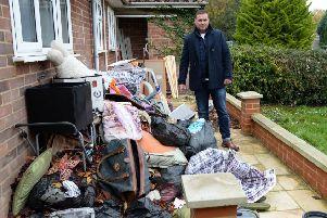 Neil Conroy's wrecked rental house in Wing