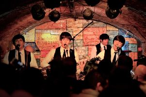 The Mersey Beatles performing at the Cavern Club in Liverpool