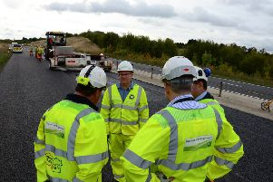 Mark Shaw, roadside briefing from contractors, Stoke Hammond bypass Photo by Buckinghamshire County Council.
