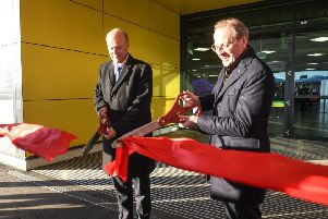 Secretary of State for Transport Chris Grayling MP and Nick Barton CEO of London Luton Airport cutting ribbon