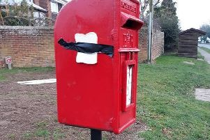 Bread stapled to the post box in Stewkley