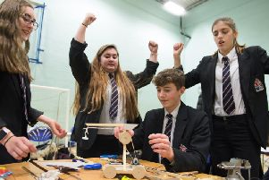 Members of the Cottesloe School team celebrate as their design appears to work successfully