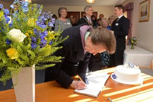 The Princess Royal signs in