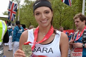 Sara with her medal after the London Marathon