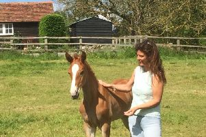 Hayley Ward with a young foal