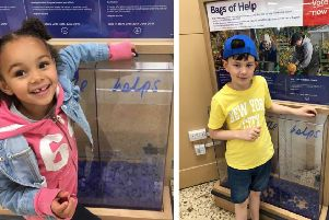 Children dropped their blue tokens into the Yes We Can section.