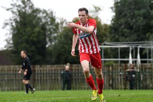 Danny Webb runs away to celebrate after scoring his penalty for Leighton Town on Saturday' PICTURE: JANE RUSSELL