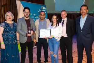 Representatives from Single Point of Access Team (second, third and fourth from left) collect their award