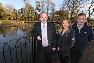 Alderman James Tinsley, Chair of the council's Leisure and Community Development Committee, with Biodiversity Officer Tracey Connolly and Stephen Mackle, Grounds Maintenance Officer, at the refurbished duck pond in Wallace Park, Lisburn.