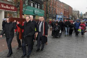 The Rt Rev Dr Noble McNeely (Moderator of the General Assembly) pictured with Lisburn City Centre Clergy at the 'Good Friday carrying of the cross walk of witness' in Lisburn.