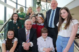 Alderman Tommy Jeffers, Chairman of the council's Environmental Services Committee, and TV presenter Paul Clarke are pictured with the top three winners in the Junior and Senior sections of the Environmental Youth Speak competition. Pic by Philip Magowan