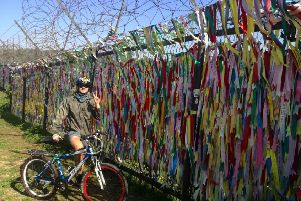 Matthew Redmond at the demilitarized zone in Korea just before he set off on his epic cycle.
