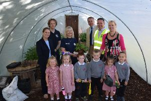 Pictured in the new polytunnel at Fort Hill Integrated Primary School are school pupils and the School Principal along with representatives from Tesco Lisburn, Lisburn & Castlereagh City Council and J P Corry who helped the school with this green project.