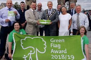 Pictured receiving the three Green Flag awards for Lisburn & Castlereagh City Council are: Jim Ros, Director of Leisure & Community Wellbeing; Ryan Osborne, Lisburn & Castlereagh City Council; Ian Humphreys, Keep Northern Ireland Beautiful; Davy Irwin, Mayor Cllr Uel Mackin; Stephen Mackle; Carolyn Thomas; William Torrens and Ross Gillanders, Lisburn & Castlereagh City Council.'Front Row L-R: Nicola Fitzsimons and Jen Firth, Keep Northern Ireland Beautiful.