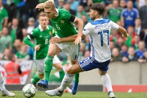 Northern Ireland's George Saville looks to be brought down by Bosnia defender Ervin Zukanovic.