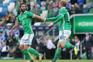 Northern Ireland striker Will Grigg celebrates with Liam Boyce, after scoring against Bosnia and Herzegovina.