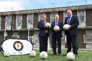 Maghaberry Prison has teamed up with Ulster GAA to coach skills for Gaelic football to prisoners as part of a sports rehabilitation initiative. 20-prisoners have taken part in the GAA Foundation Award course in which they were coached in skills and rules for football. Pictured (left-right) are Ronnie Armour, Director General of the Northern Ireland Prison Service, Michael Hasson, President Ulster GAA, and David Kennedy, Maghaberry Prison Governor. Picture: Michael Cooper