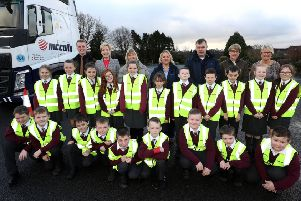 Pupils of Largymore Primary School that took part in a Road Safety Week initiative run by McCulla Transport, Dennisons Commerical and Lisburn & Castlereagh City Council are pictured with Councillor Janet Gray MBE, Chair of the Council's Environmental Services Committee.