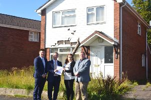 Cllr Scott Carson, Sir Jeffrey Donaldson MP, resident Sophie Bagguley and Cllr Jonathan Craig outside on of the former MoD homes in the Mountview area of Lisburn.