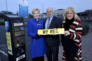The picture issued on Friday of the chairman of Lisburn & Castlereagh City Council's Environmental Services Committee, Councillor Janet Gray MBE; vice-chairman Alderman James Tinsley and director of environmental services Heather Moore introducing the new updated ticketing system for the council's off-street pay and display car parks. The picture, which the council has insisted was 'for illustrative purposes only', was later recalled after the roll-out of the proposed scheme was suspended.