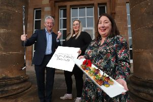 Marking Northern Ireland's growing reputation as a food, golf and Game of Thrones destination are (l-r) John McGrillen, Chief Executive of Tourism NI, Pia-Marlen Veit, Service Reisen Frankfurt and Siobhan McManamy, Director of Markets, Tourism Ireland. Pic William Cherry