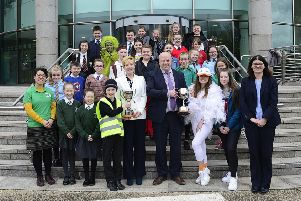 All the participants in the 2019 Environmental Youth Speak from schools across the Lisburn Castlereagh area are pictured with Councillor Janet Gray MBE, Chair of the Council's Environmental Services Committee; Alderman James Tinsley, Vice-Chair of the Environmental Services Committee and Noeleen O'Malley, Waste Policy & Development Manager.