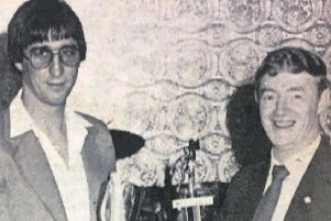 Mr D McGreavey presents leading goalscorer G Murphy with a trophy in 1980