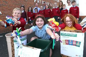 Members of the Eco Council at Pond Park Primary School show Alderman James Baird, Chairman of Lisburn & Castlereagh City Council's Environmental Sevices Committee their recycling efforts that will save the school up to �2,000 per year.  Also pictured are teachers from the school and the Principal Mr Cherry.