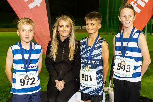 Scott Owen (middle) from Lagan Valley Athletics Club stormed to first place in the U13 1500m race with a time of 5.03.29. Pictured with Scott are Colm McKee (left) and Finn Cross (right) from Willowfield Harriers