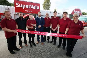 SuperValu Lisburn's Eddie Sharkey cutting the ribbon alongside store manager Jamie Graham (centre) and members of the team
